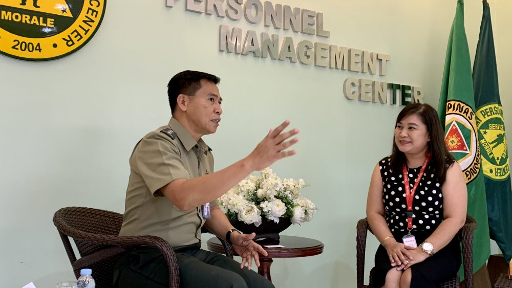 Lt. Col. Eliglen Villaflor discusses the situation of Army retirees to HR Group Manager Jaimie Natividad.