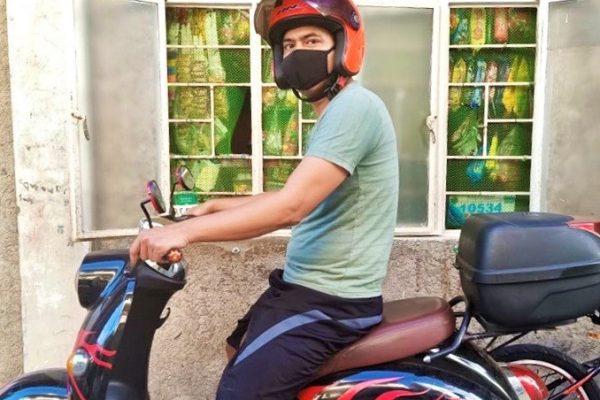 Bernard Bobos roke his e-bike to distribute food support to his fellow Chooks-to-Go crew members